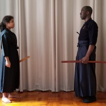 As a standard reihō when 2 people are practicing kata, they stand face to face while holding their bokuto (wooden sword) in the left hand.